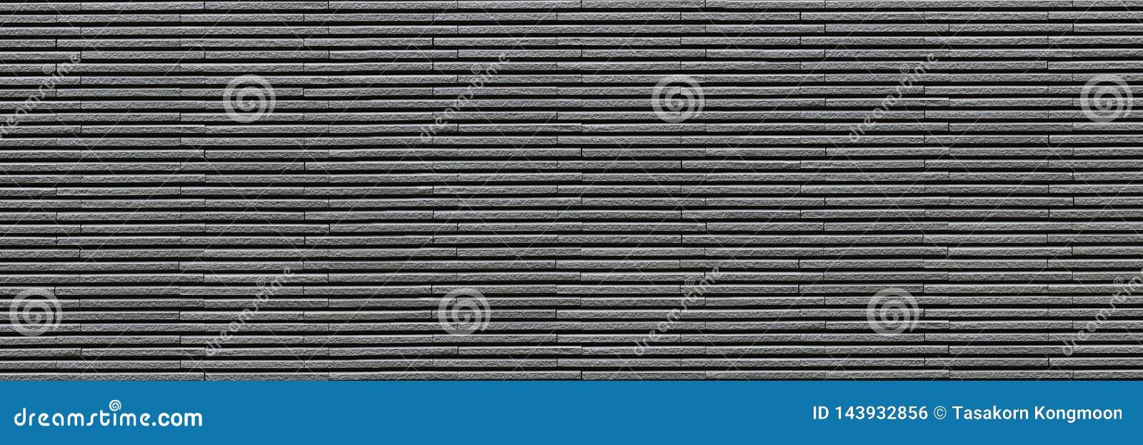 Mur de briques moderne gris-foncé horizontal pour le modèle et le fond