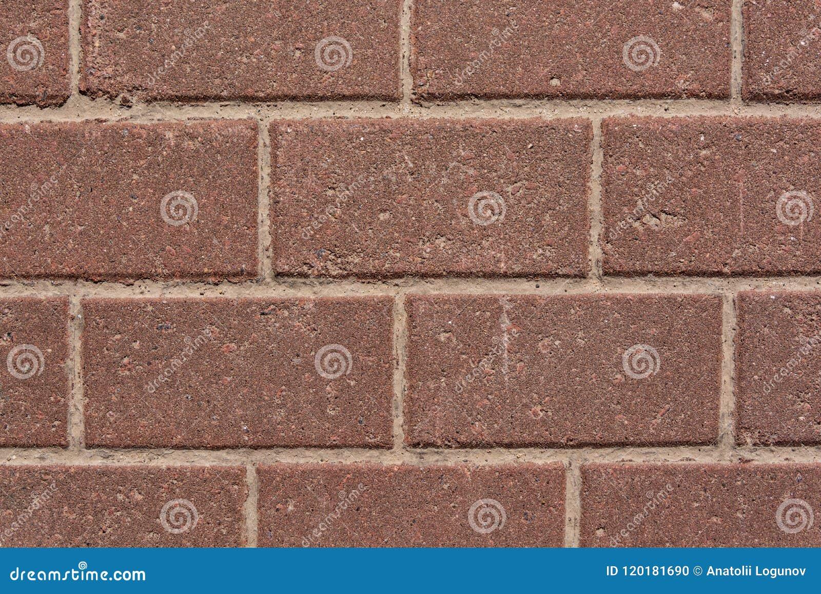 Mur des briques rouges de granit