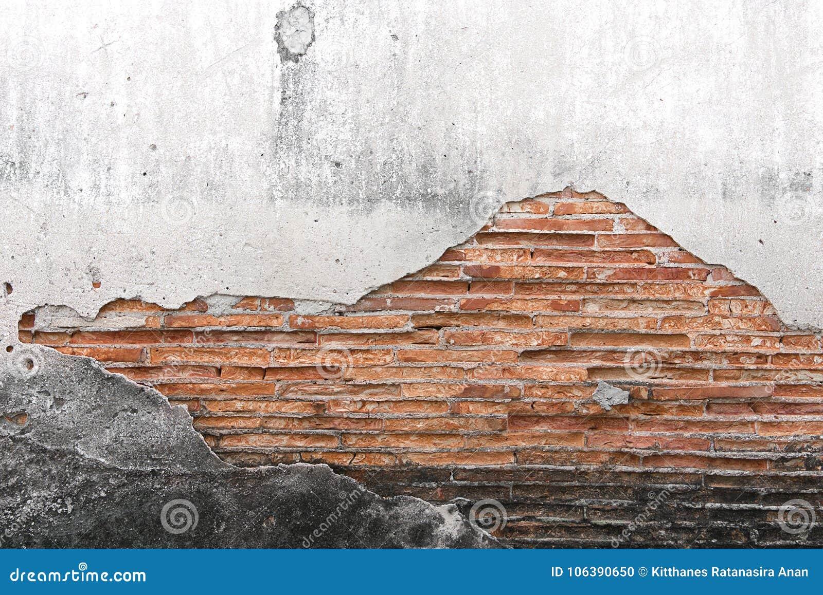 Mur en béton criqué couvert de surface grise de ciment comme backgr