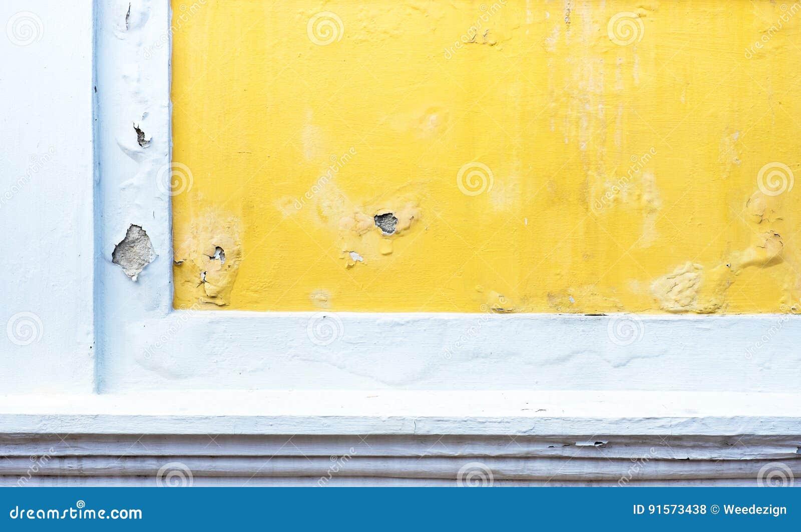 Mur En Béton De Couleur Jaune Criquée De Peinture Fond De