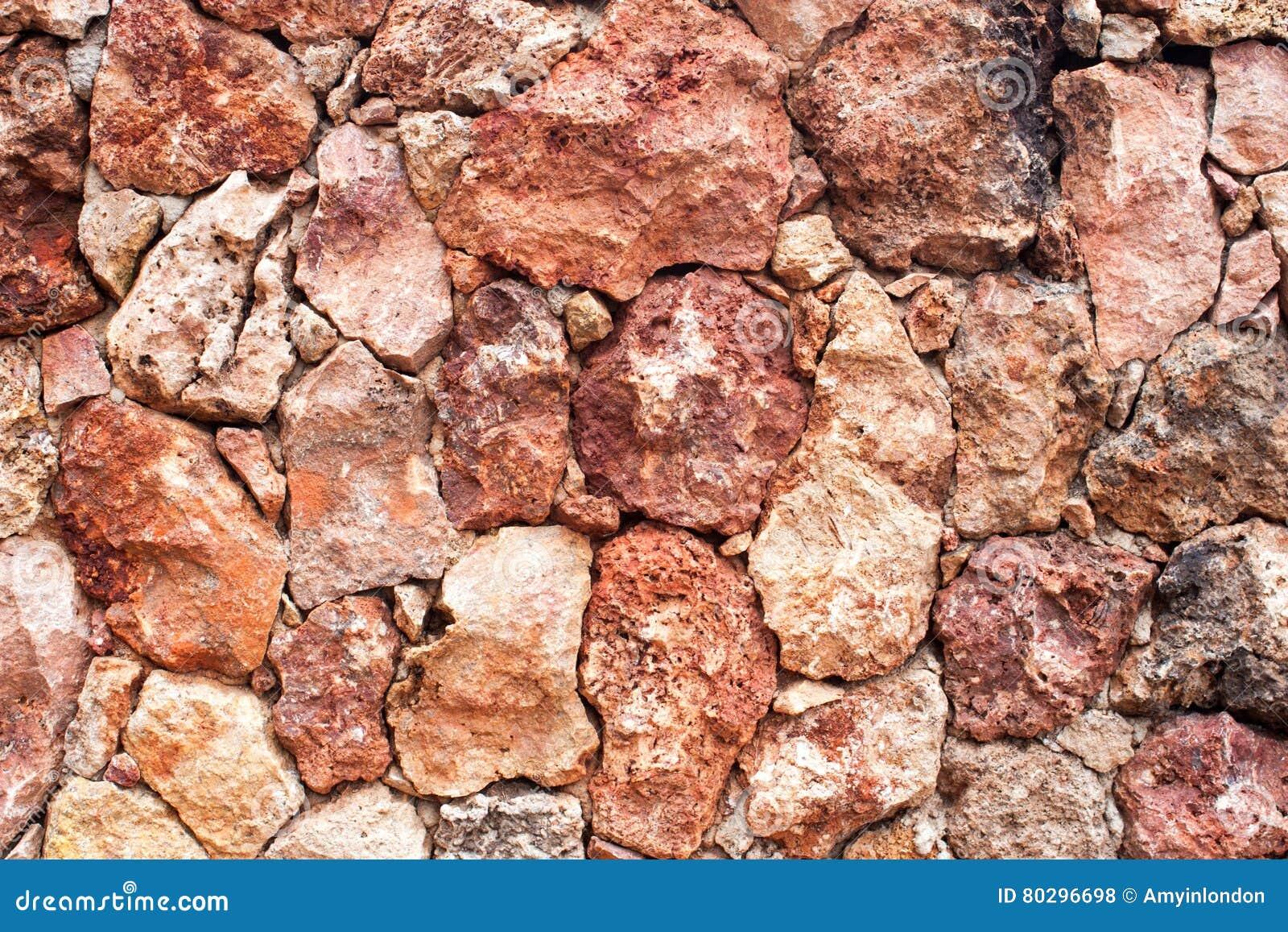 mur en pierre de lave rouge volcanique photo stock image du poreux ext rieur 80296698. Black Bedroom Furniture Sets. Home Design Ideas