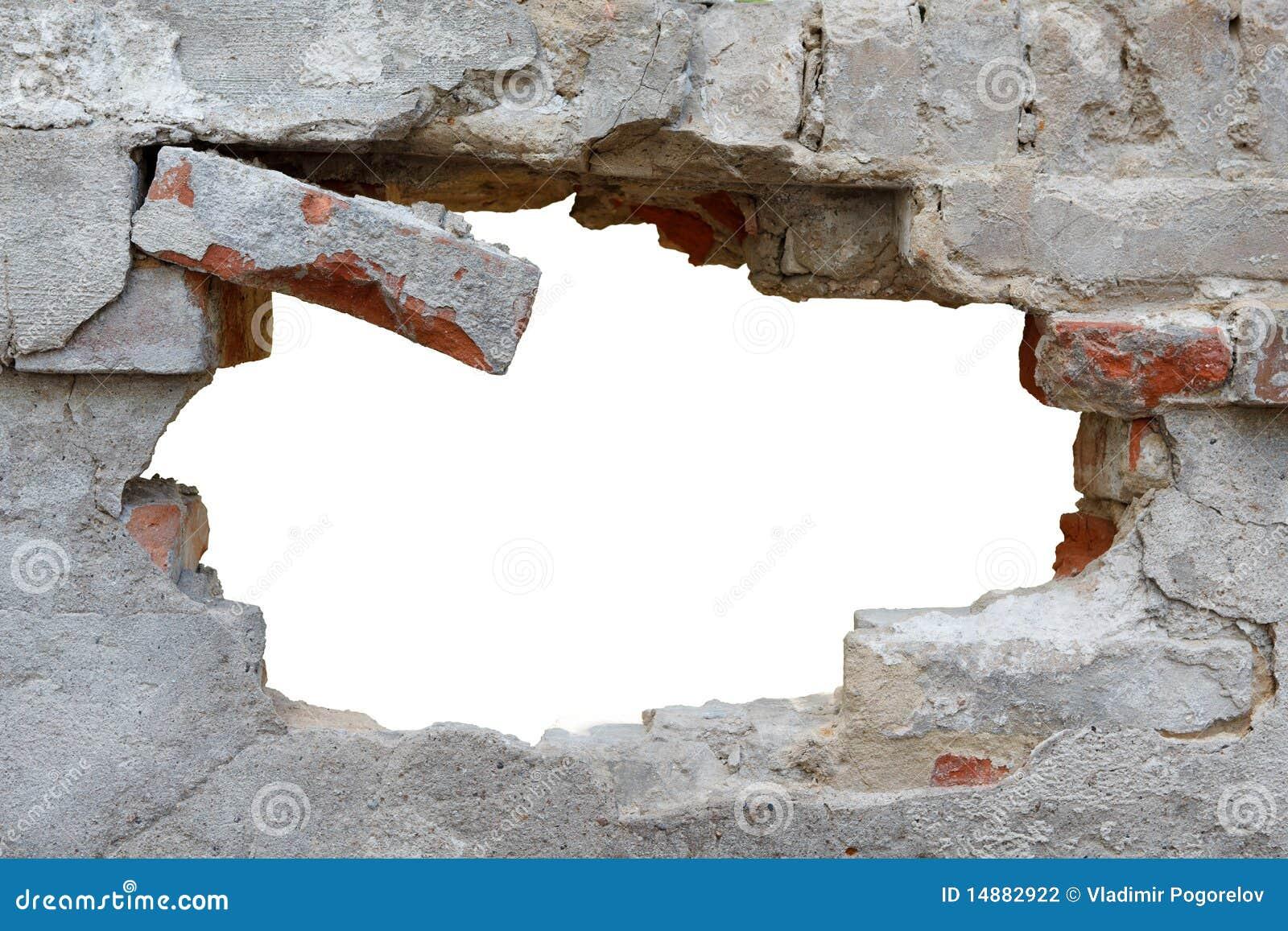 Mur endommagé avec le trou informe