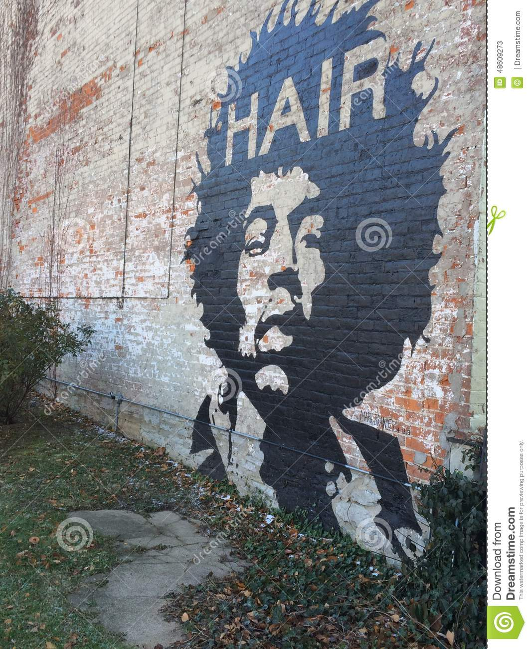 Mural on a brick wall hair editorial stock photo image for Distressed brick wall mural