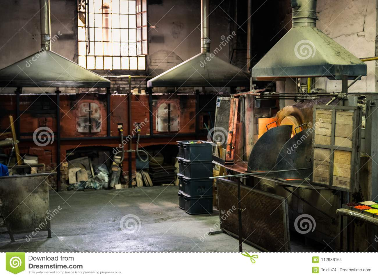 Interior of an artistic glassworks in Murano, Venice. Ancient furnace for blown glass processing.