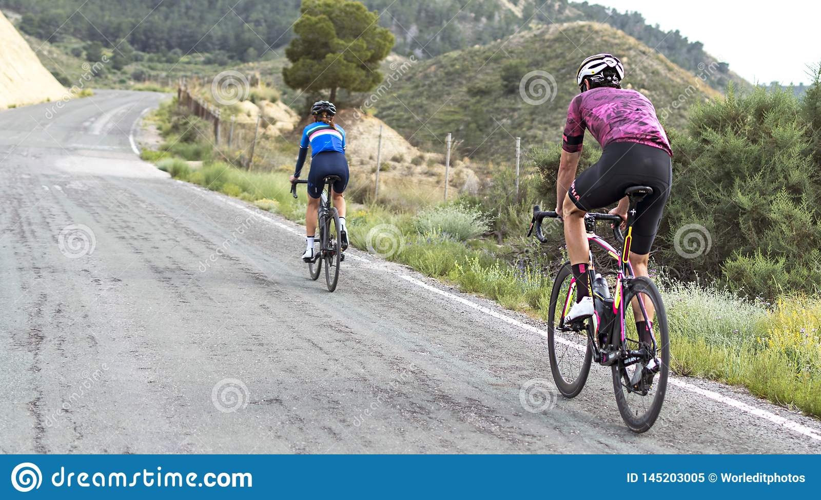 Murcia, Spain, April 17, 2019: Healthy lifestyle - teenage girl and boy cycling