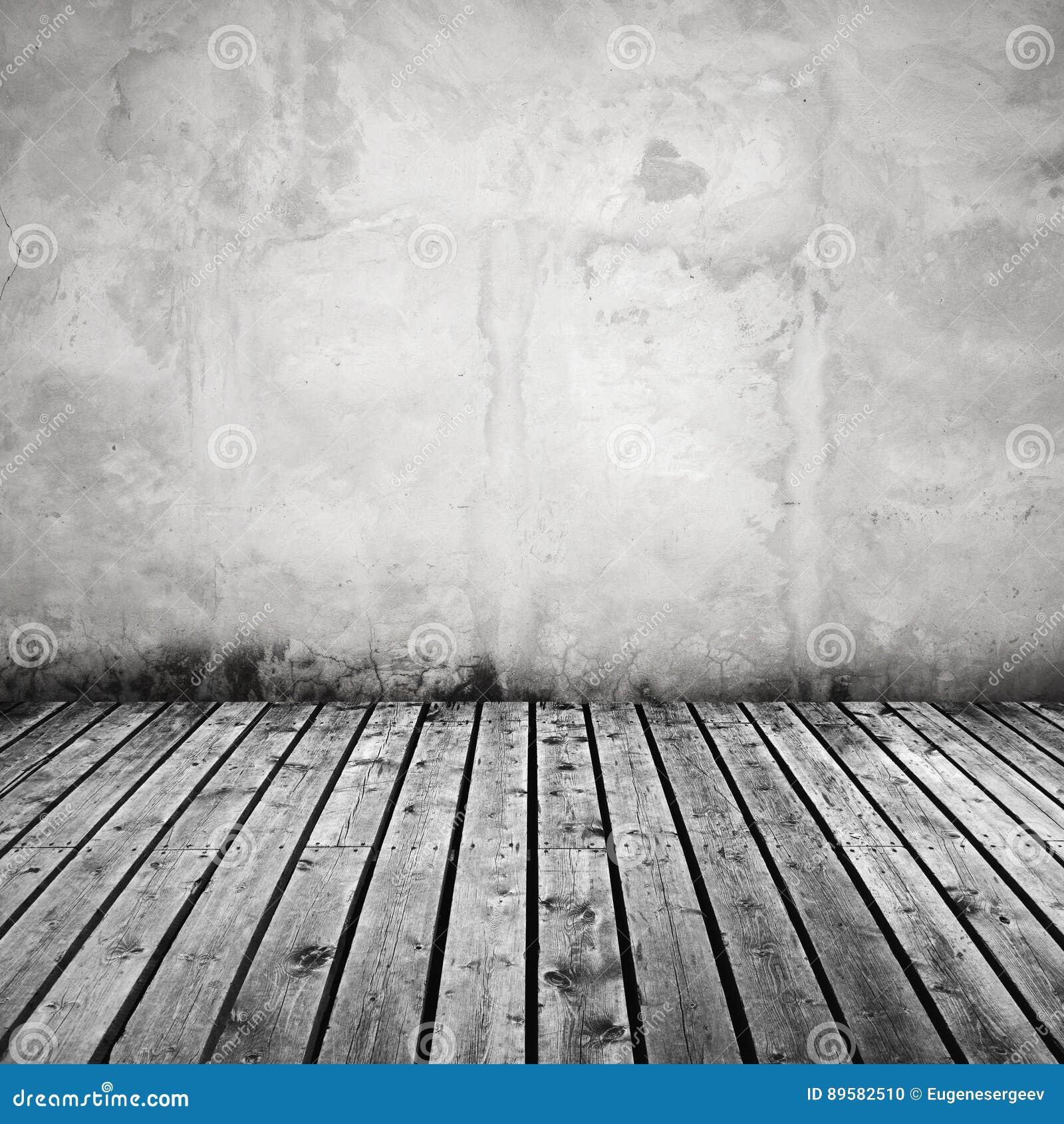 muro de cemento blanco y piso de madera gris oscuro foto de archivo