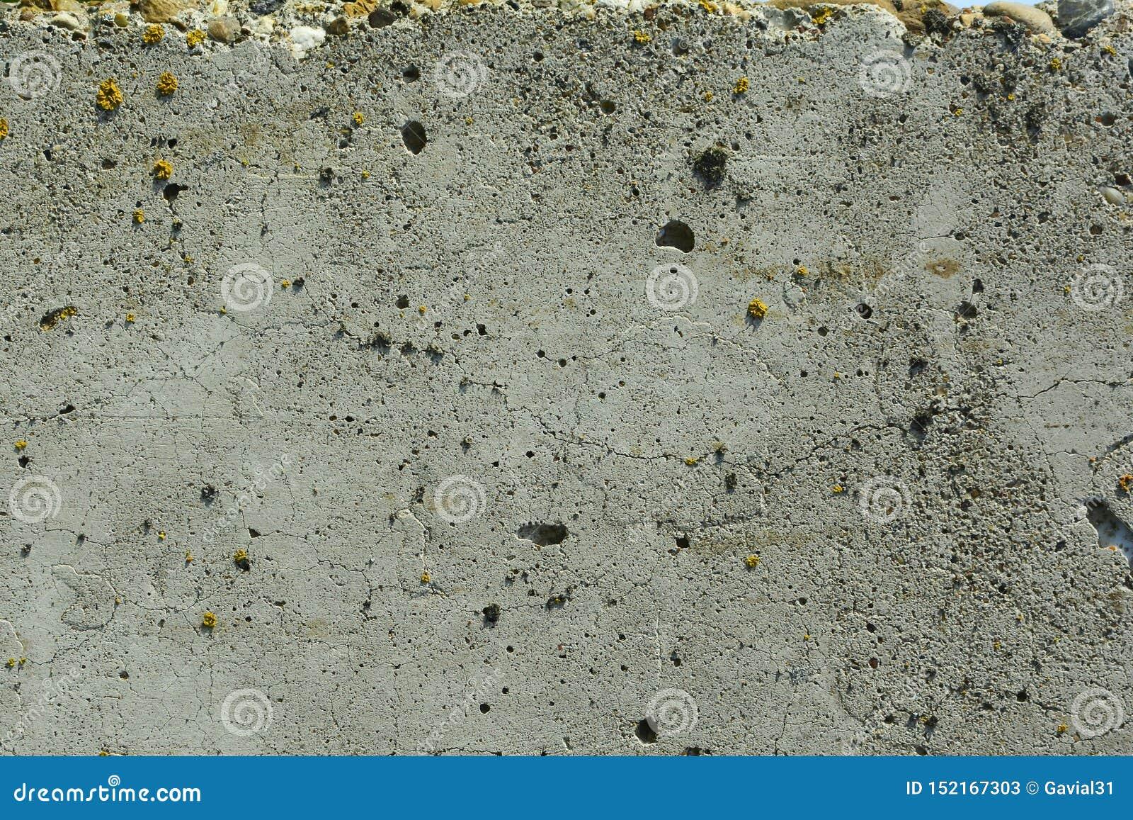 Muro de cemento gris viejo texturizado abstraiga el fondo