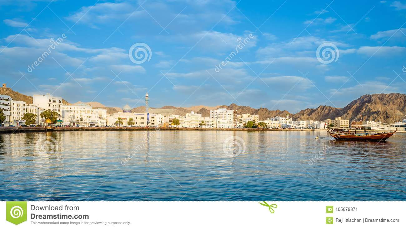 Muscat Skyline with a traditional arabic Dhow