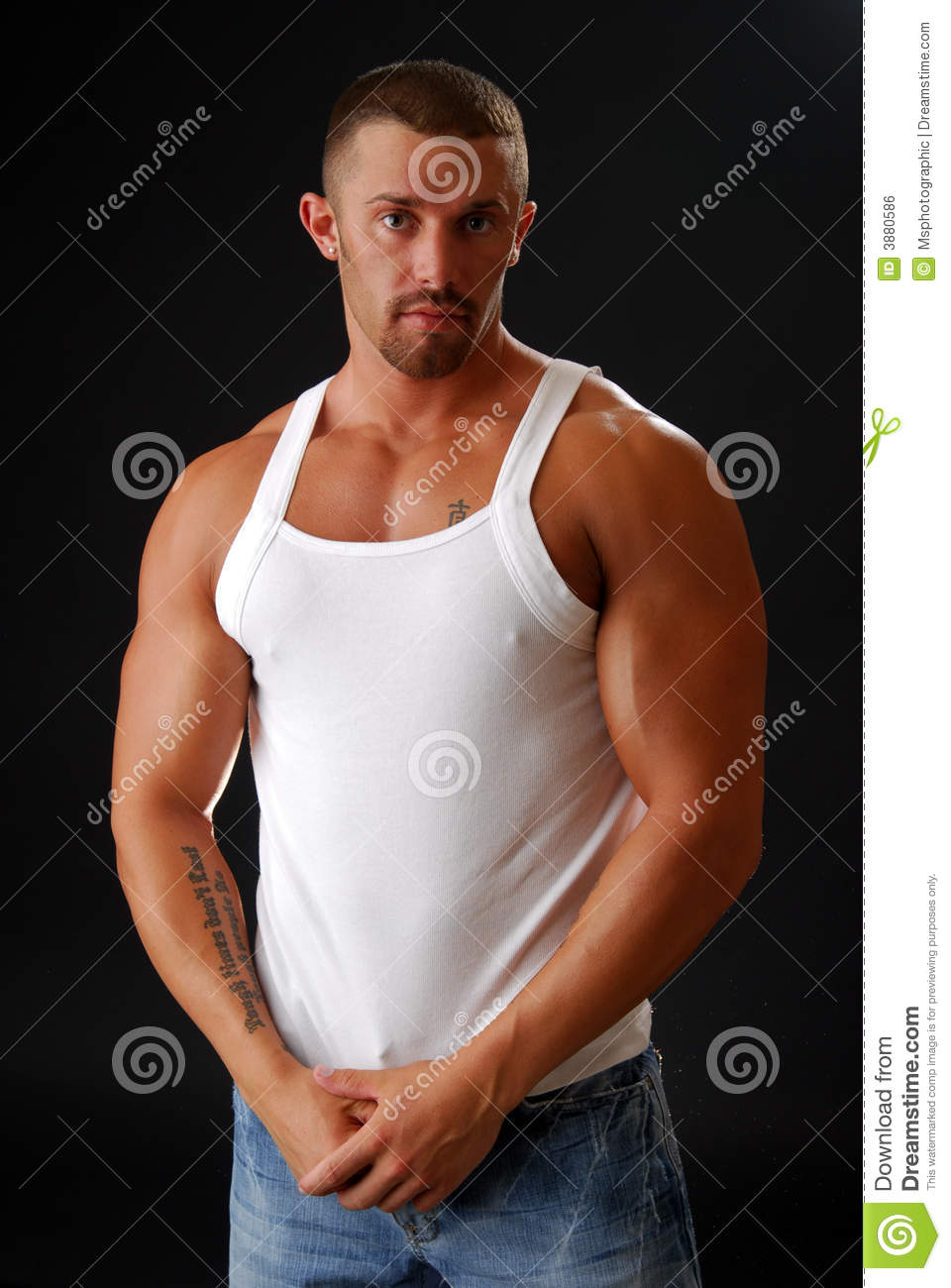Muscle Man stock photo. Image of jeans, shirt, handsome
