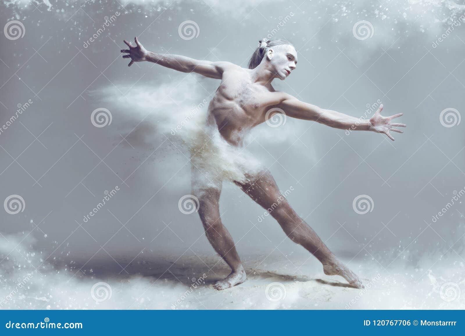 Muscle man dancer in dust / fog