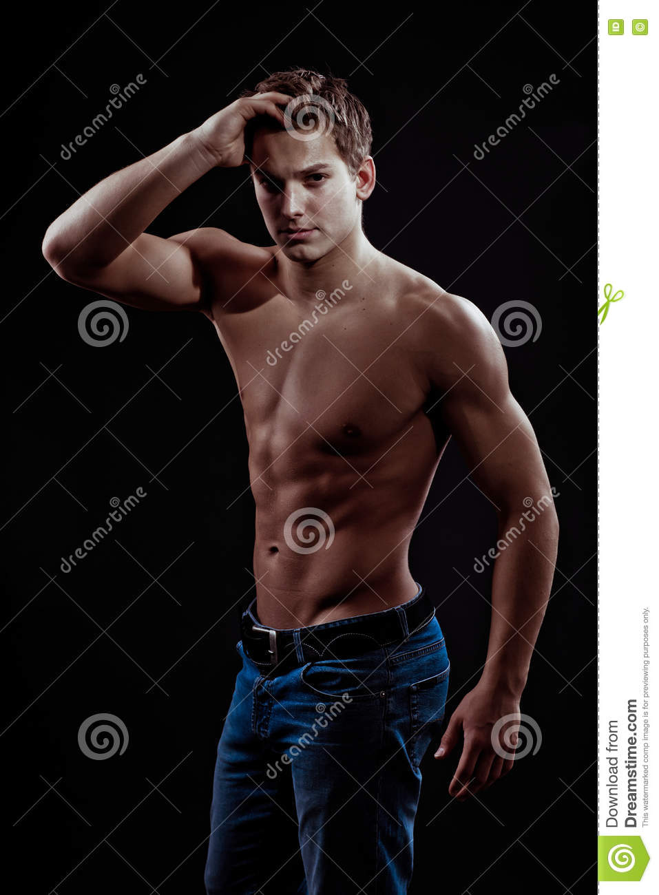 Muscular Young Guy Posing In Studio In Jeans Stock Photo