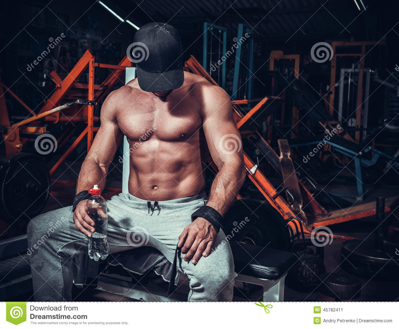 Muscle shaped man tired sitting relaxed
