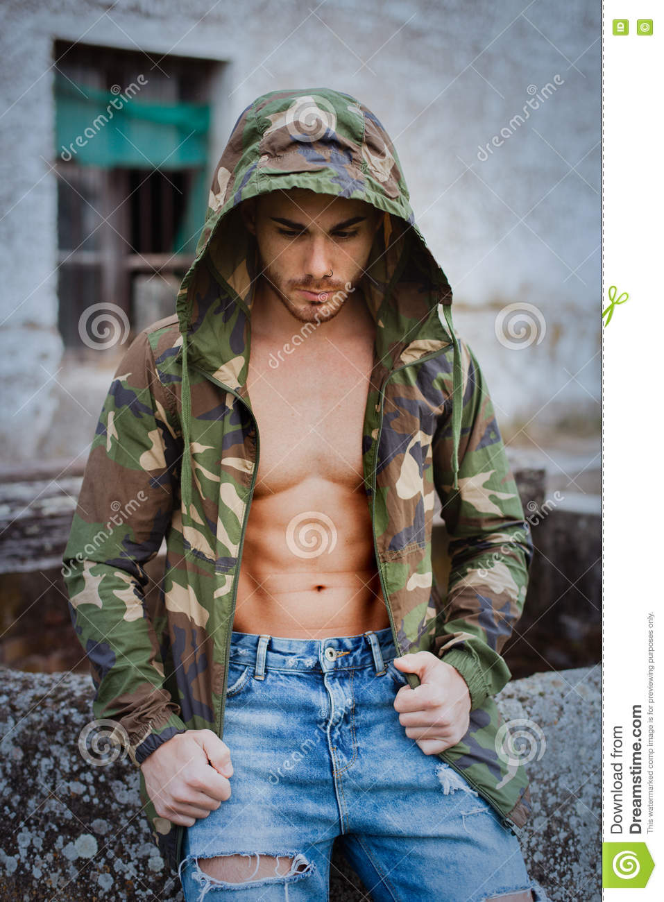 Muscled boy with camouflage jacket