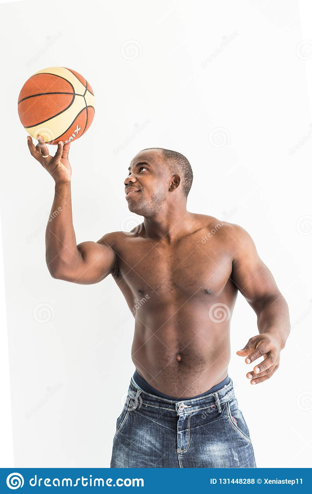 Muscular afro american athlete with basketball ball on white background