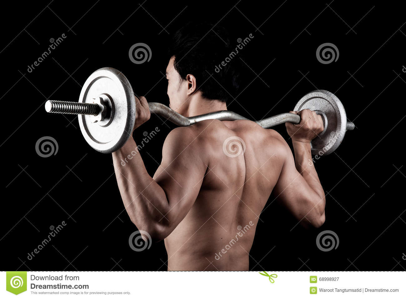 Muscular Asian man with barbell