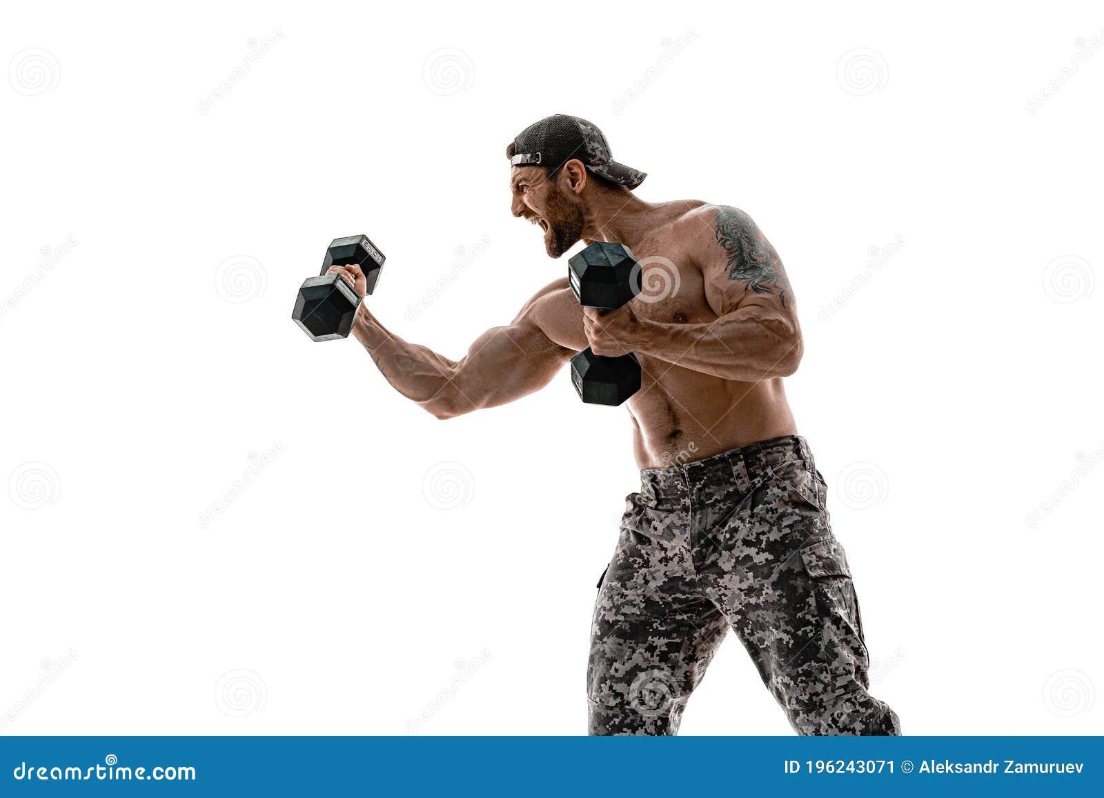 Muscular Athlete Bodybuilder Man On A Gray Background