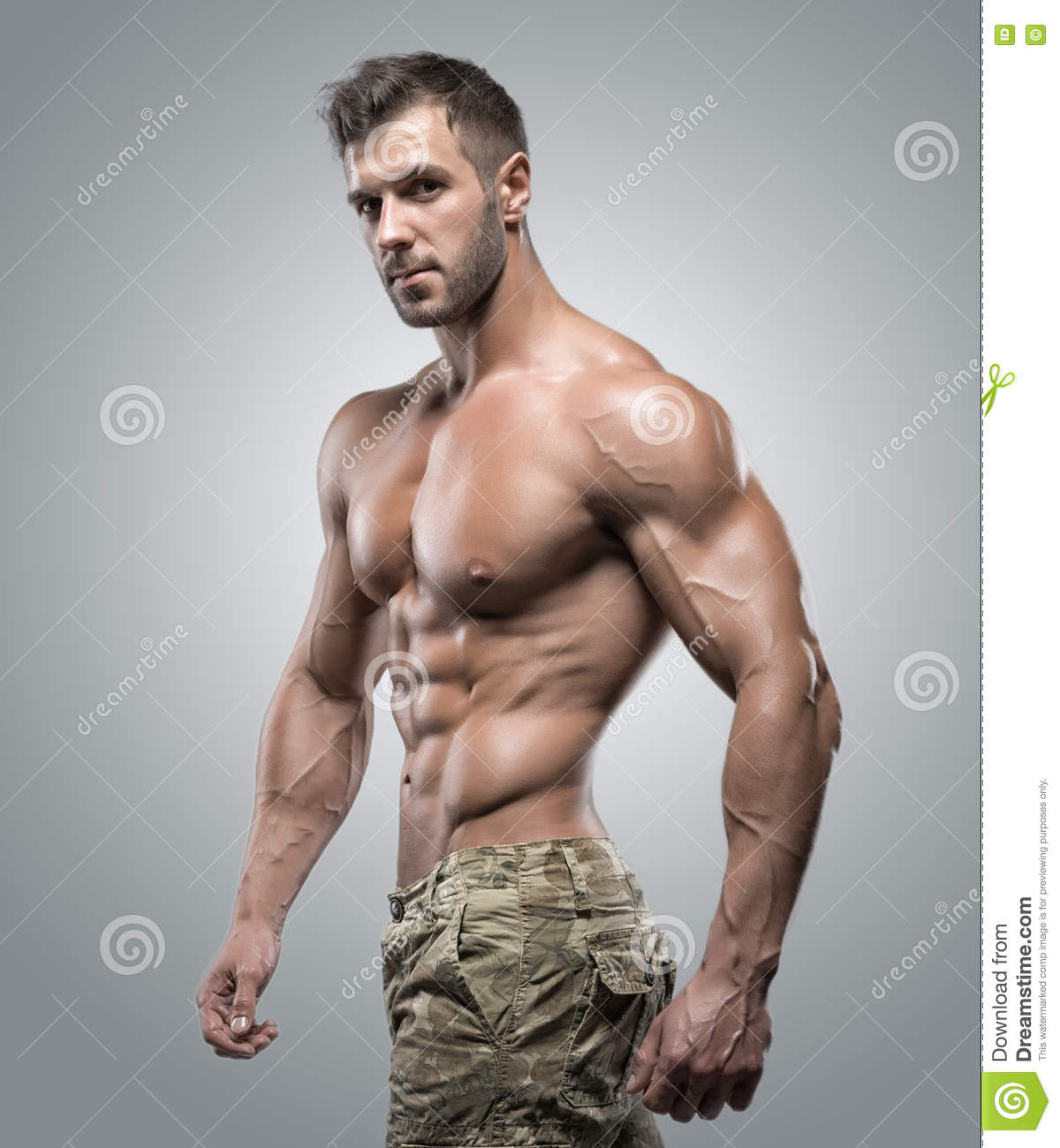Muscular Athlete Bodybuilder Man In Camouflage Pants With