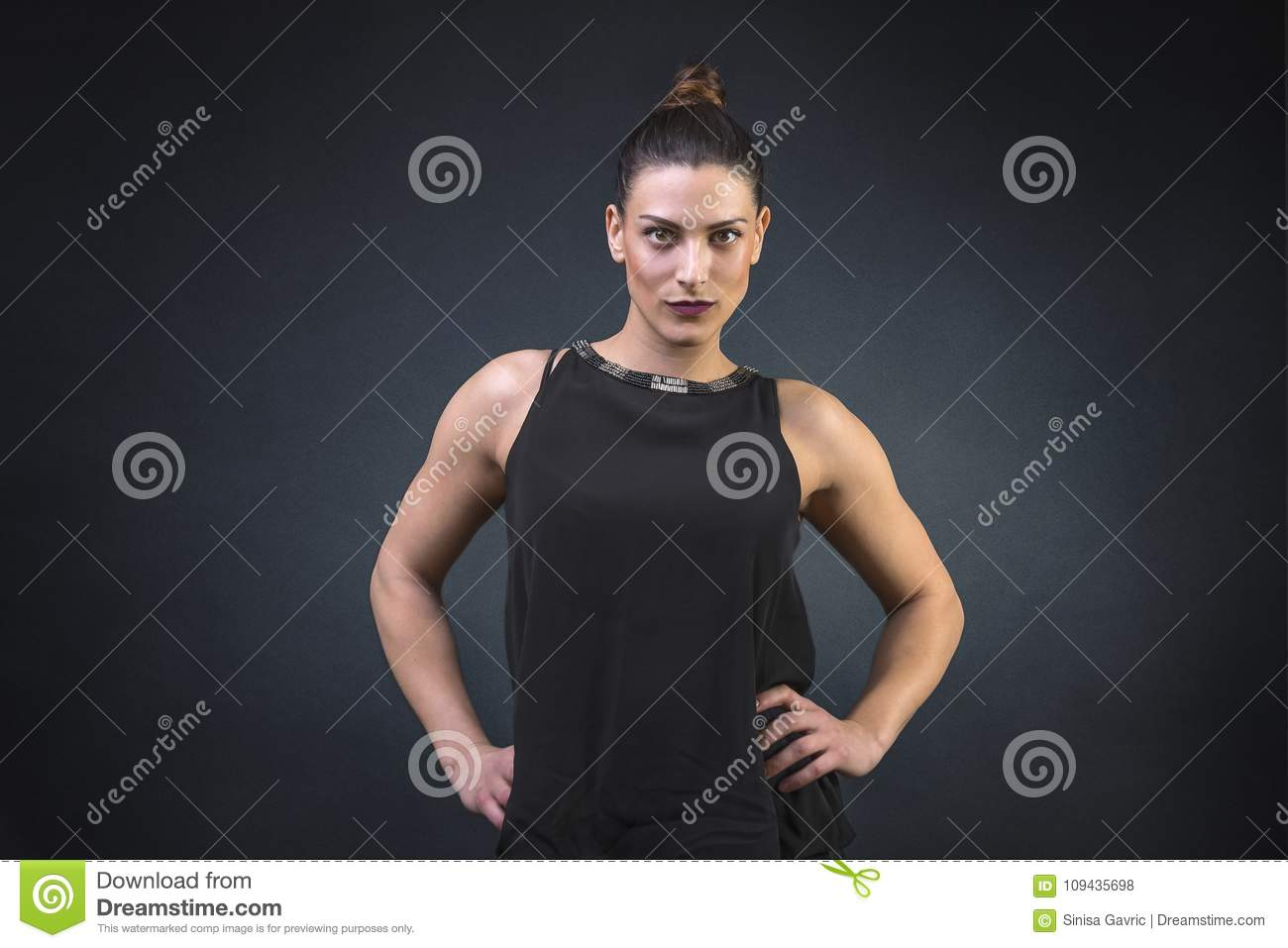 Muscular and Attractive young woman, showing off her strong build muscular body dressed for a night out