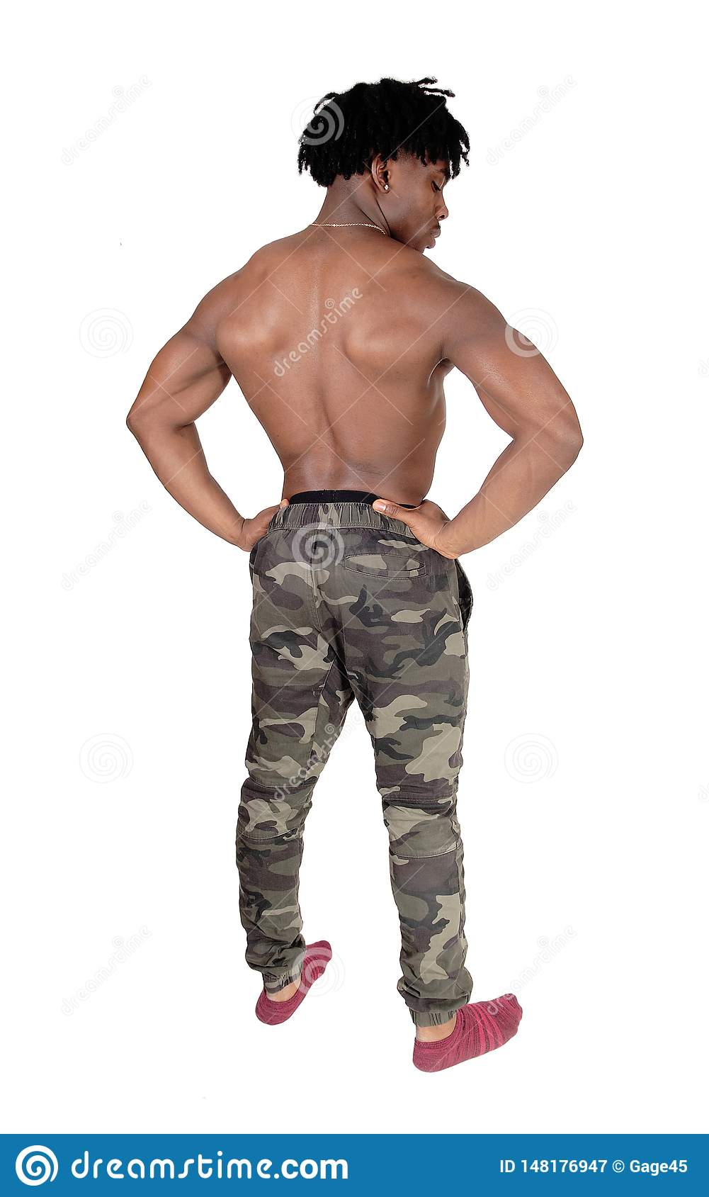 Muscular Man In Camo Pants And Jacket Stock Image