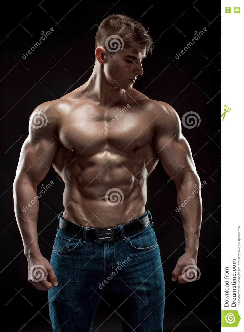 Muscular Bodybuilder Guy Doing Posing Over Black Background Stock Photo - Image Of -6241