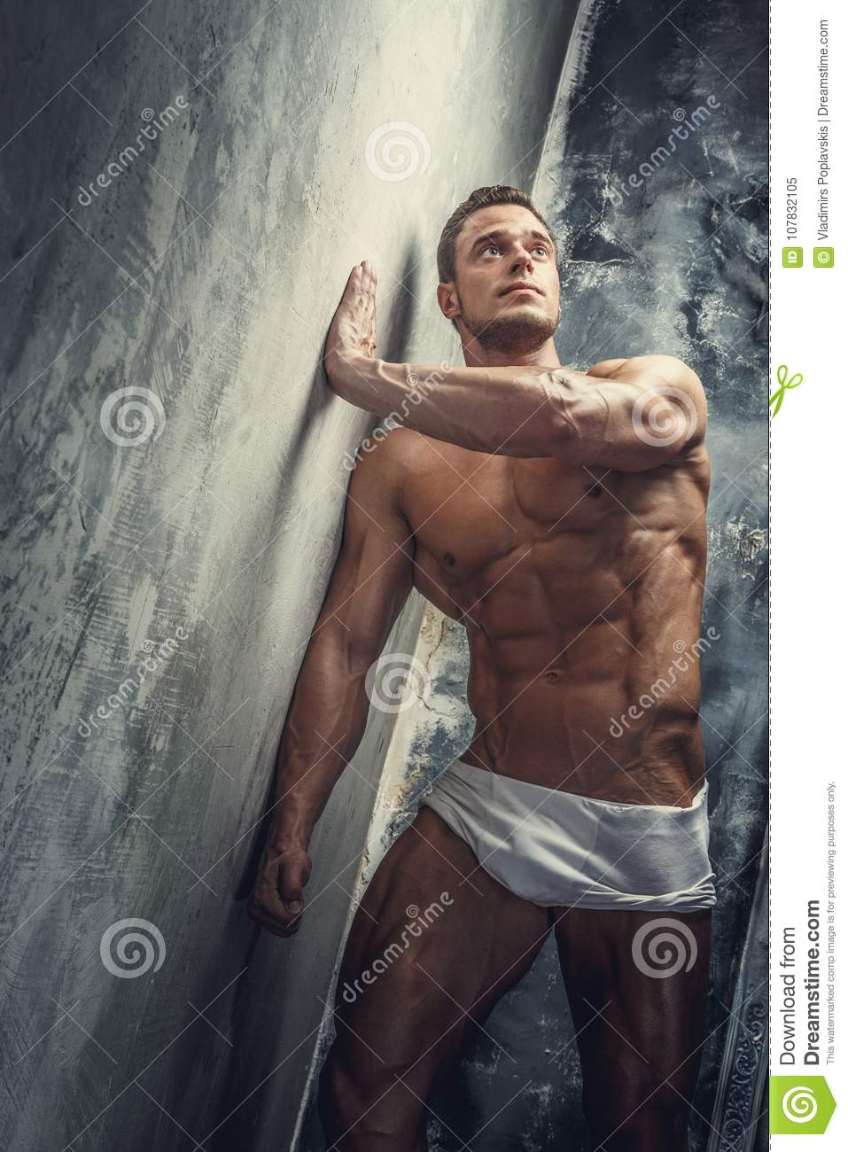 Portrait Of A Shirtless Muscular Young Man Stock Photo
