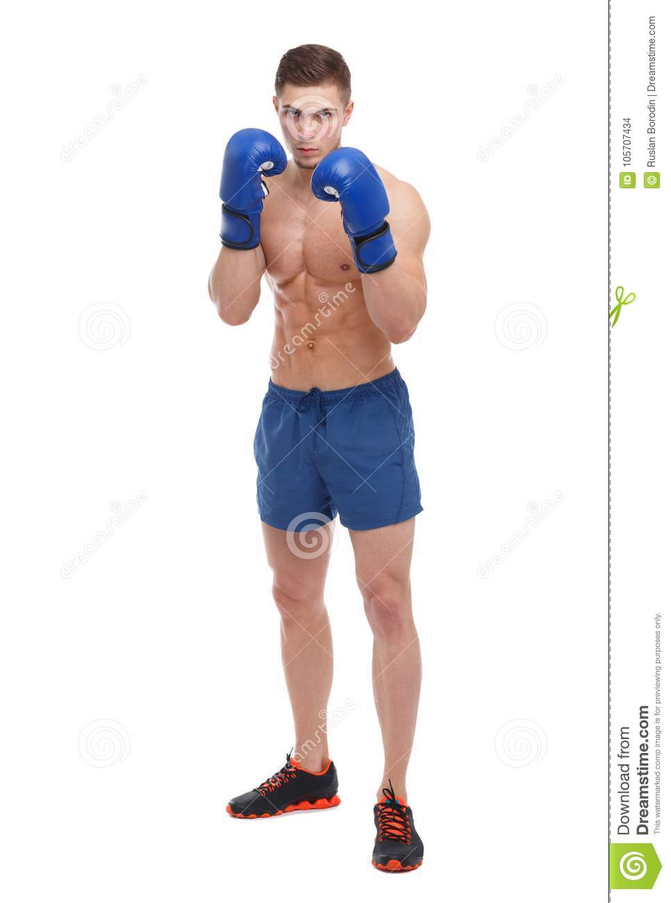 A Muscular Guy In Boxing Gloves Is Standing In A Fighting ...