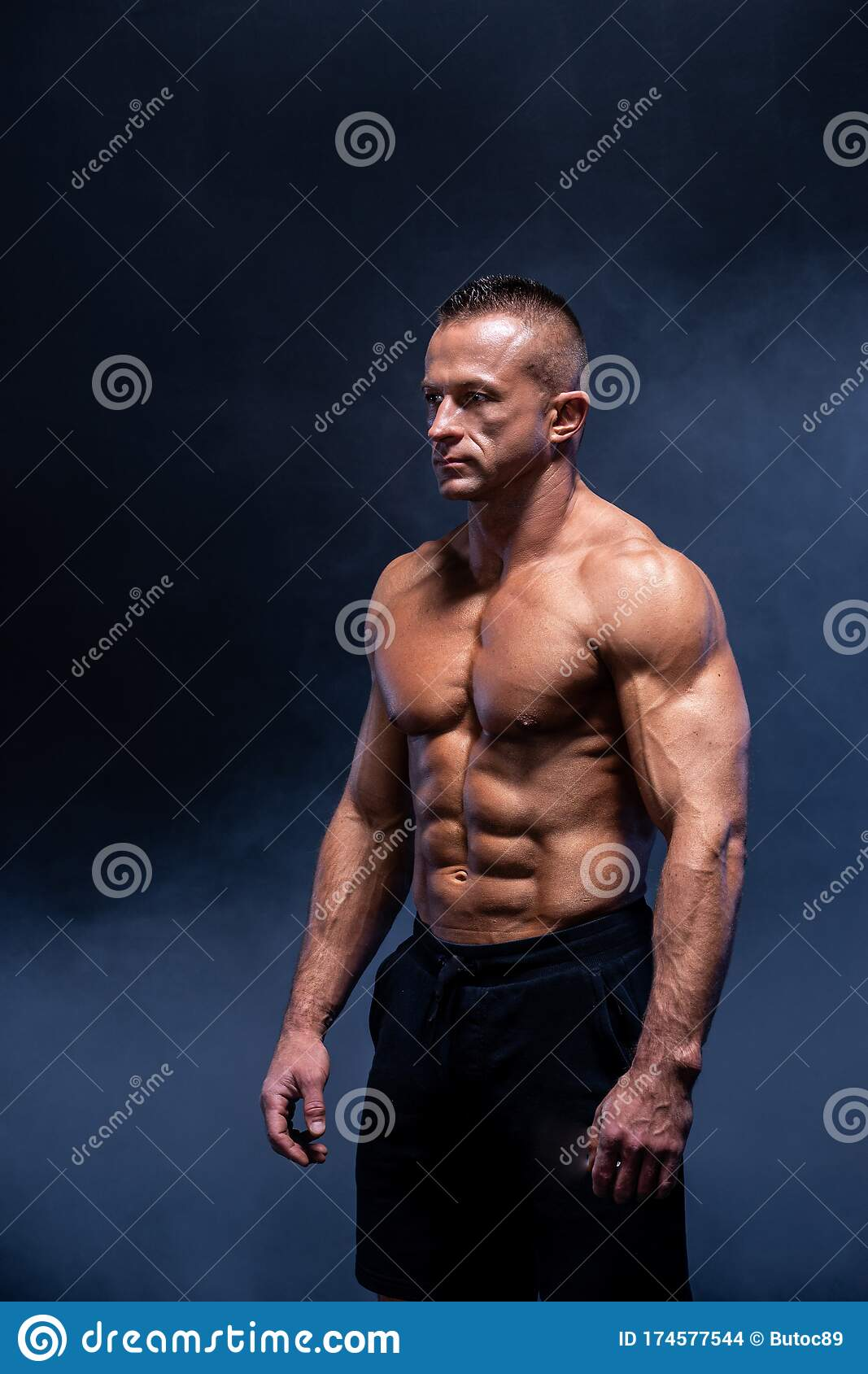 Muscular Man Isolated On The Black Background. Strong Male