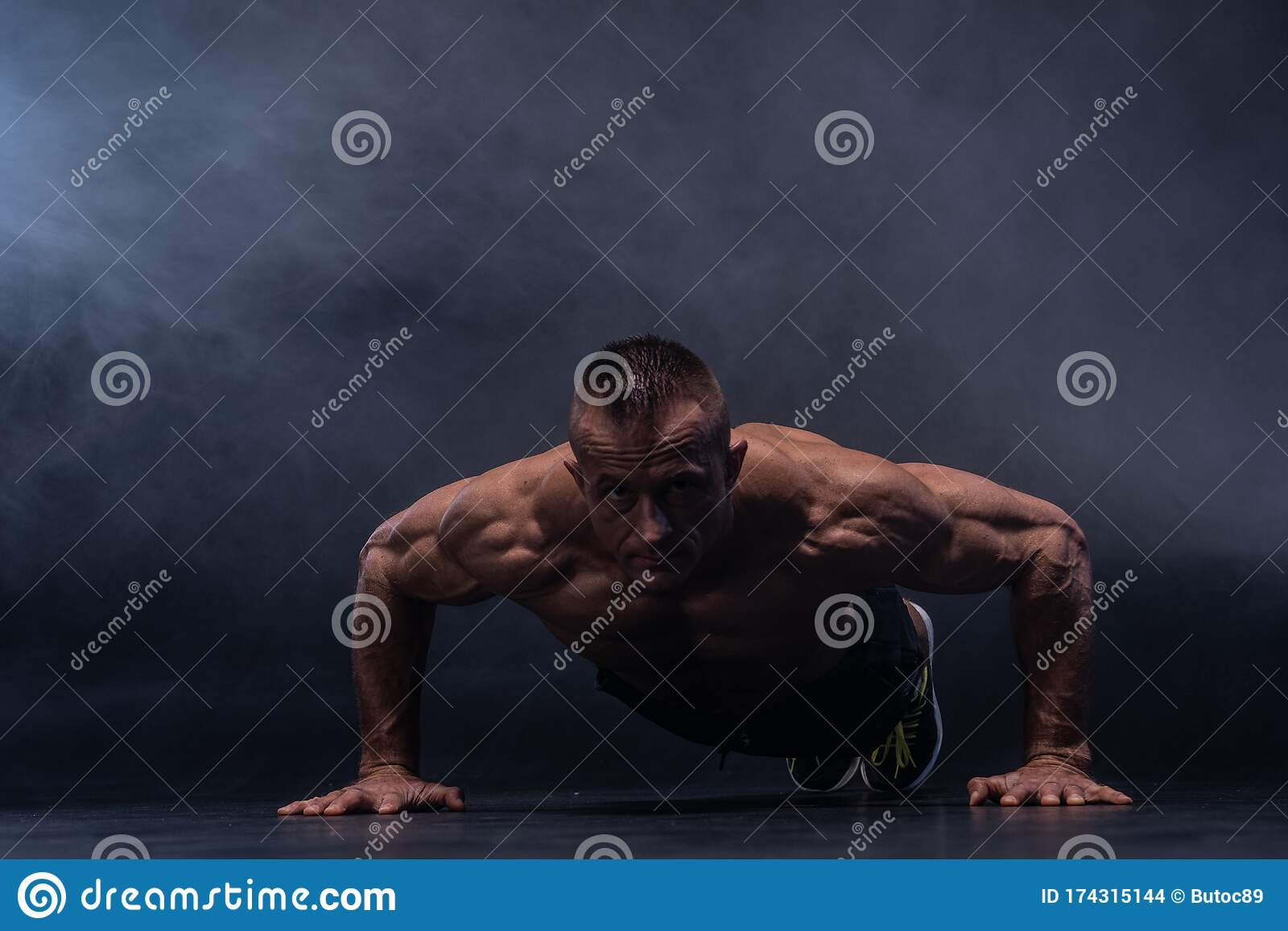 Closeup View Of Young Athletic Muscular Man Doing Push-ups