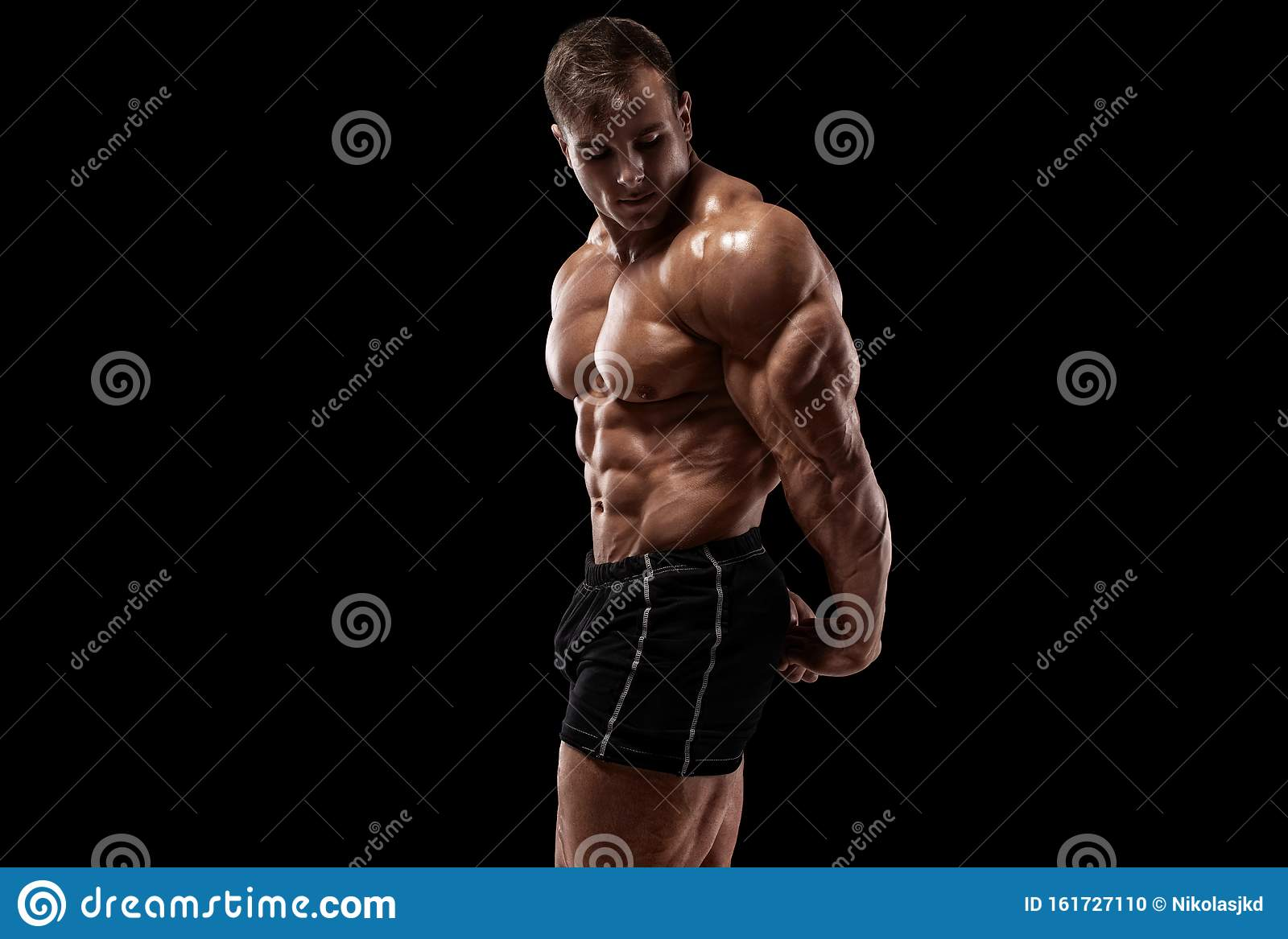 Muscular Man On The Black Background. Strong Male Naked