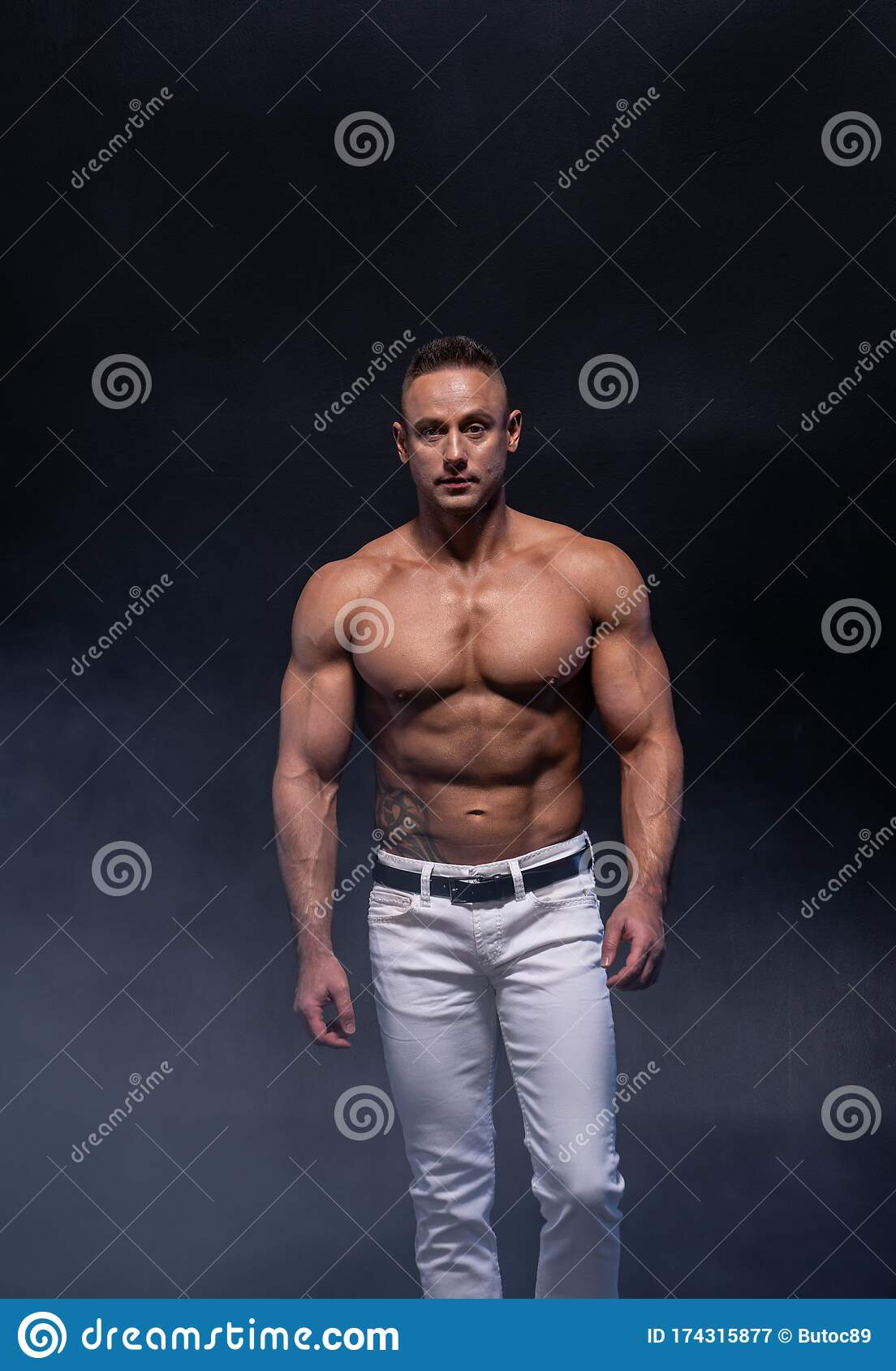 Two Muscular Man Isolated On The Black Background. Strong