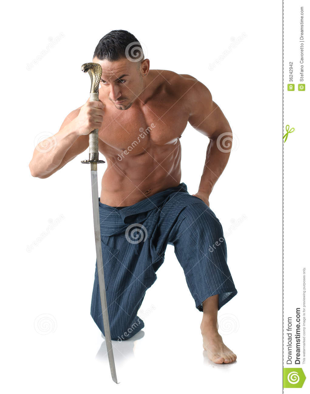 Muscular Man Kneeling On The Floor Shirtless With