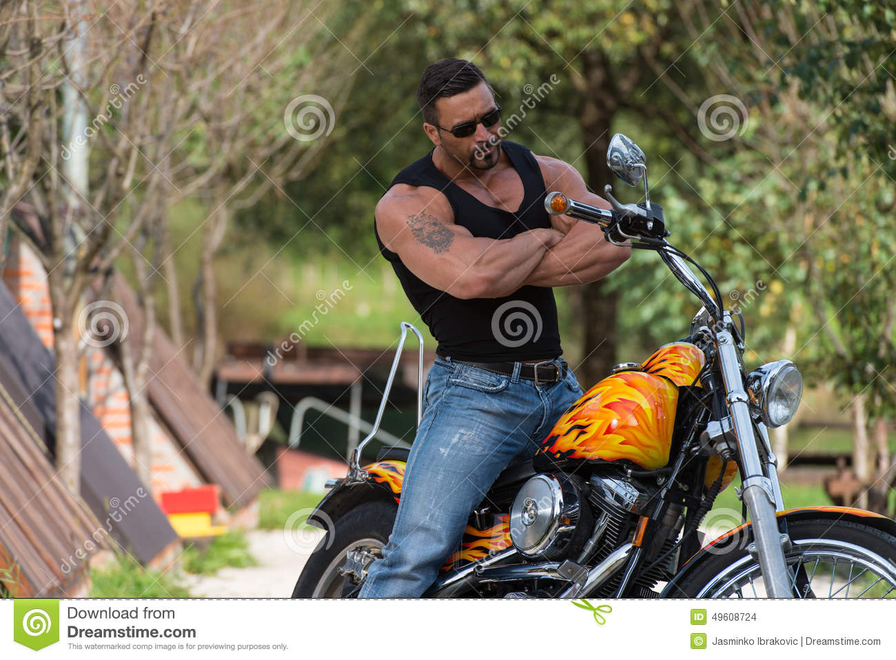 Muscular Man And Motorcycle
