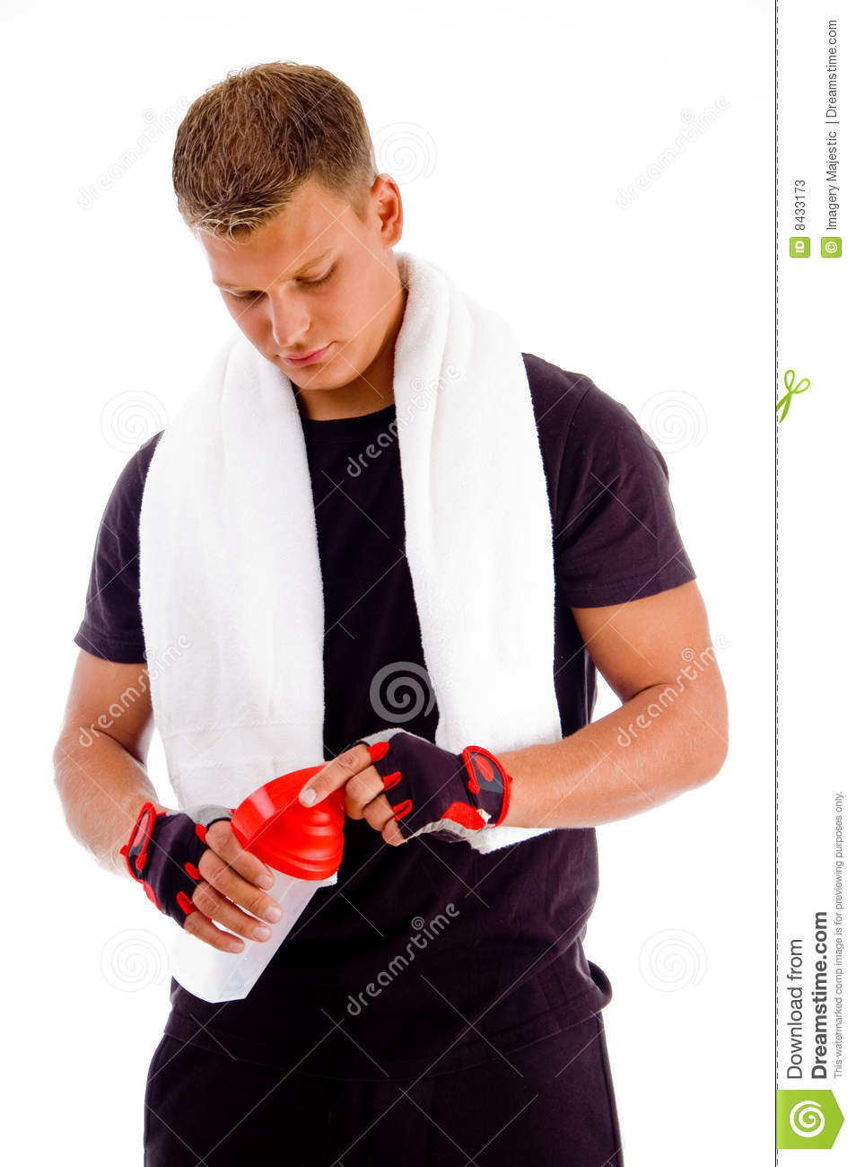 Muscular man opening the cap of water bottle