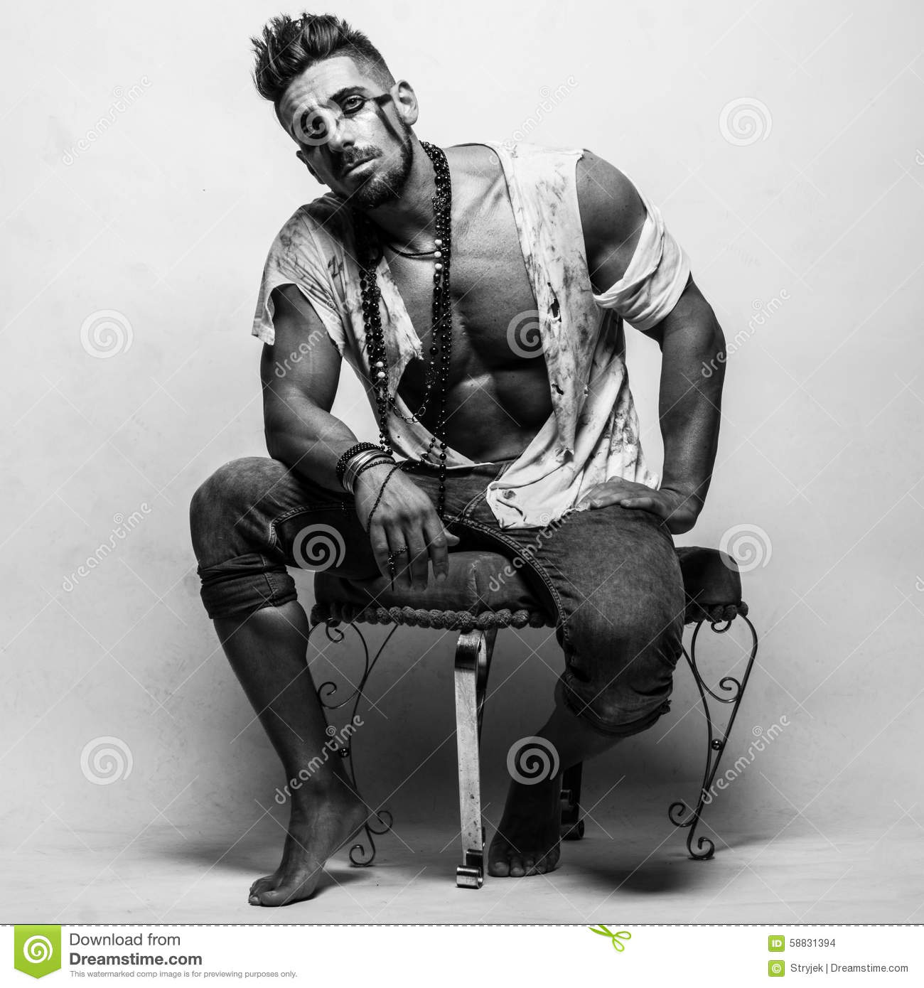 Muscular Man In Ragged Clothes Sitting On A Chair Stock ...  Ragged Clothes