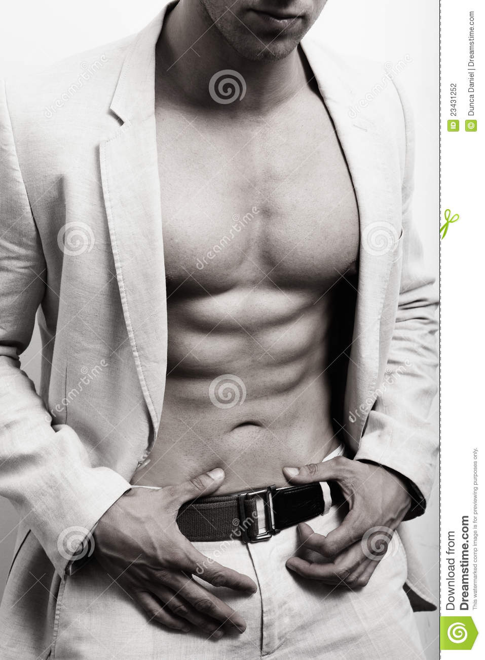 Muscular man with abs and suit