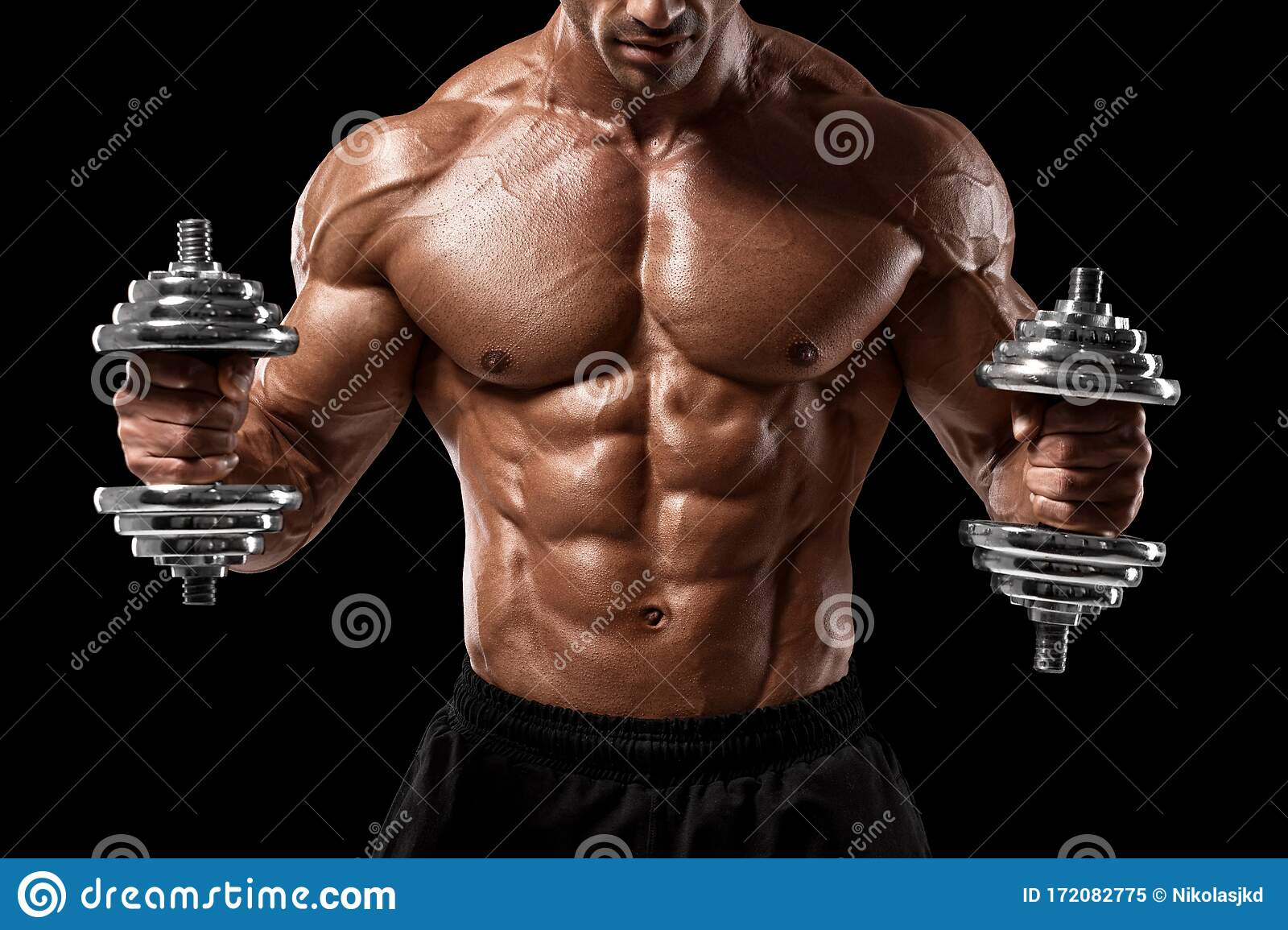 Muscular Man With Dumbbells Isolated On Black Background