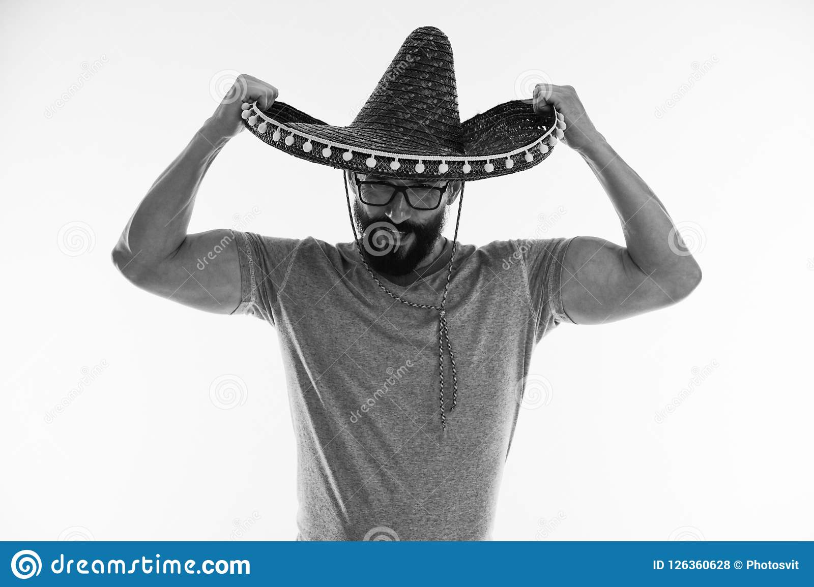 35686379 Muscular man in sombrero. Mexican man keep sombrero hat in muscular hands.  Strength and masculinity. In love with mexico, black and white.