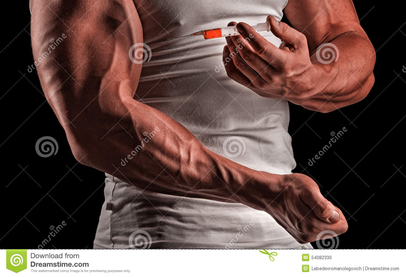 A Muscular Man With A Syringe Stock Photo - Image of