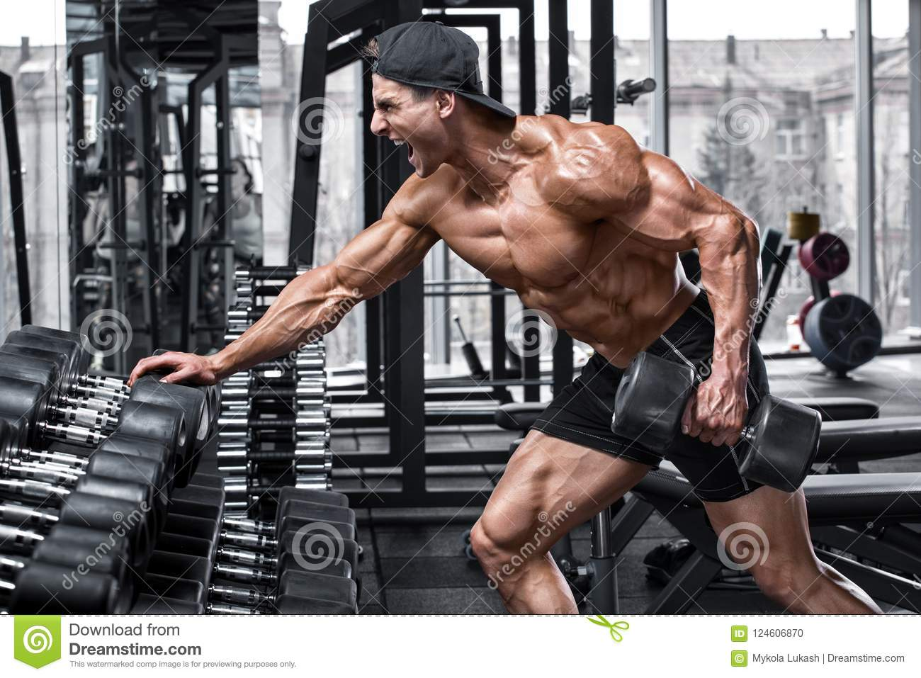 Muscular Man Working Out In Gym Doing Exercises For Back Single Arm Dumbbell Row Stock Photo Image Of Single Athletic 124606870