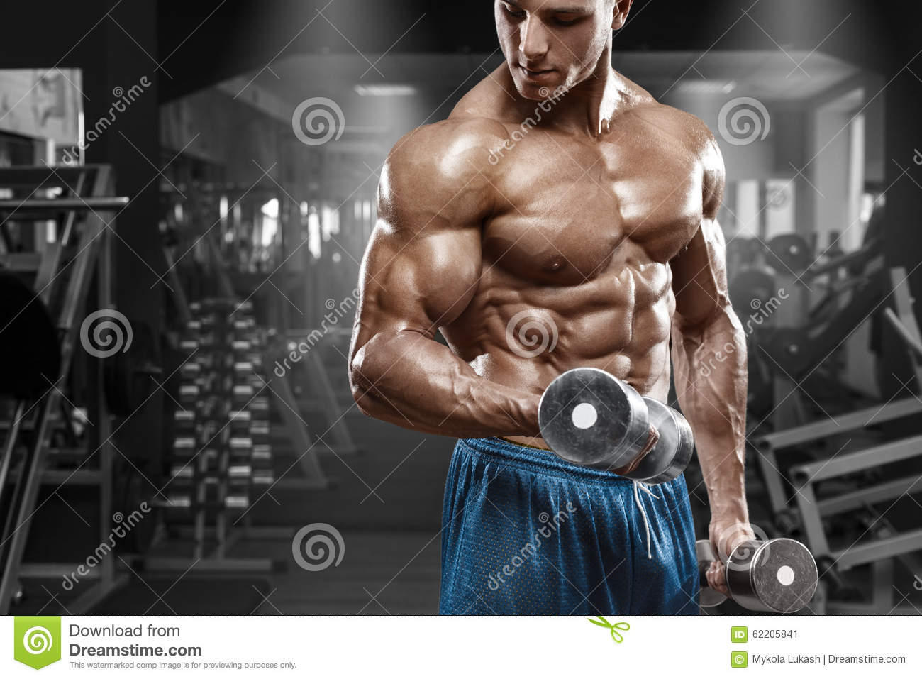 Muscular Man Working Out In Gym Doing Exercises With -2466