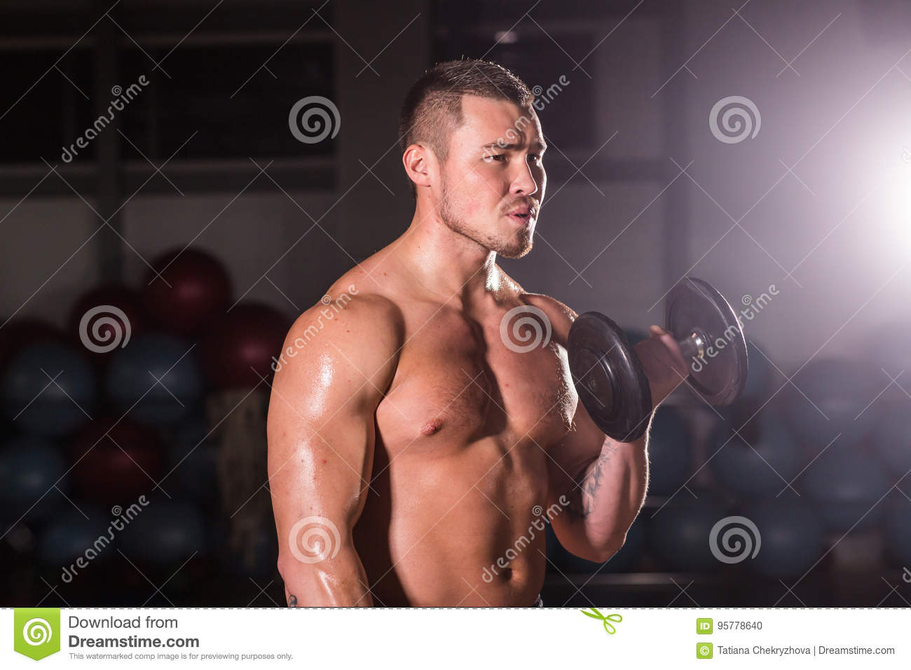 Muscular Man Working Out In Gym Doing Exercises, Strong