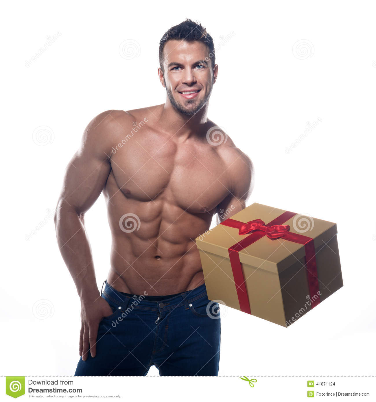 Muscular man with a gift stock photo. Image of costume