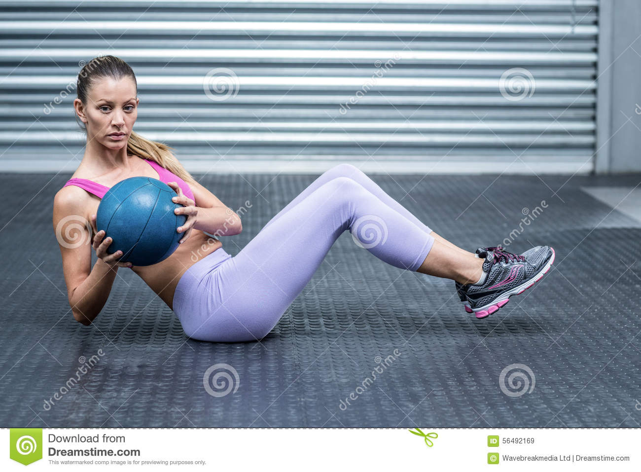 A muscular woman doing core exercises