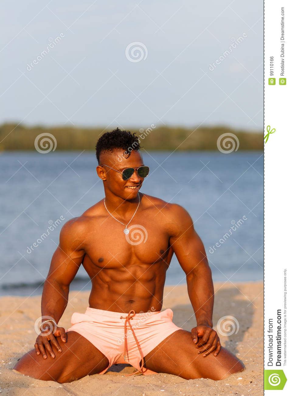 Muscular Young Athletic Man On The Beach With A Naked
