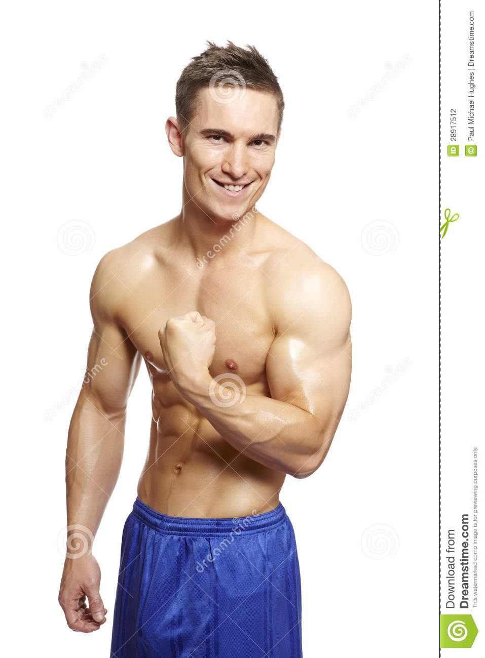... Photography: Muscular young man flexing arm muscles in sports outfit