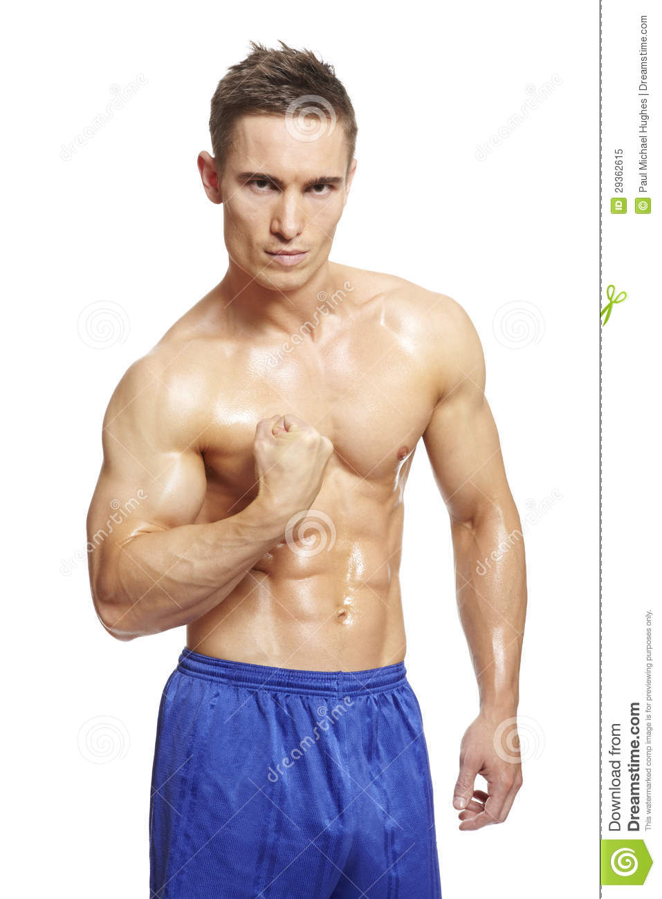 Muscular Young Man Flexing Arm Muscles In Sports Outfit Royalty Free ...