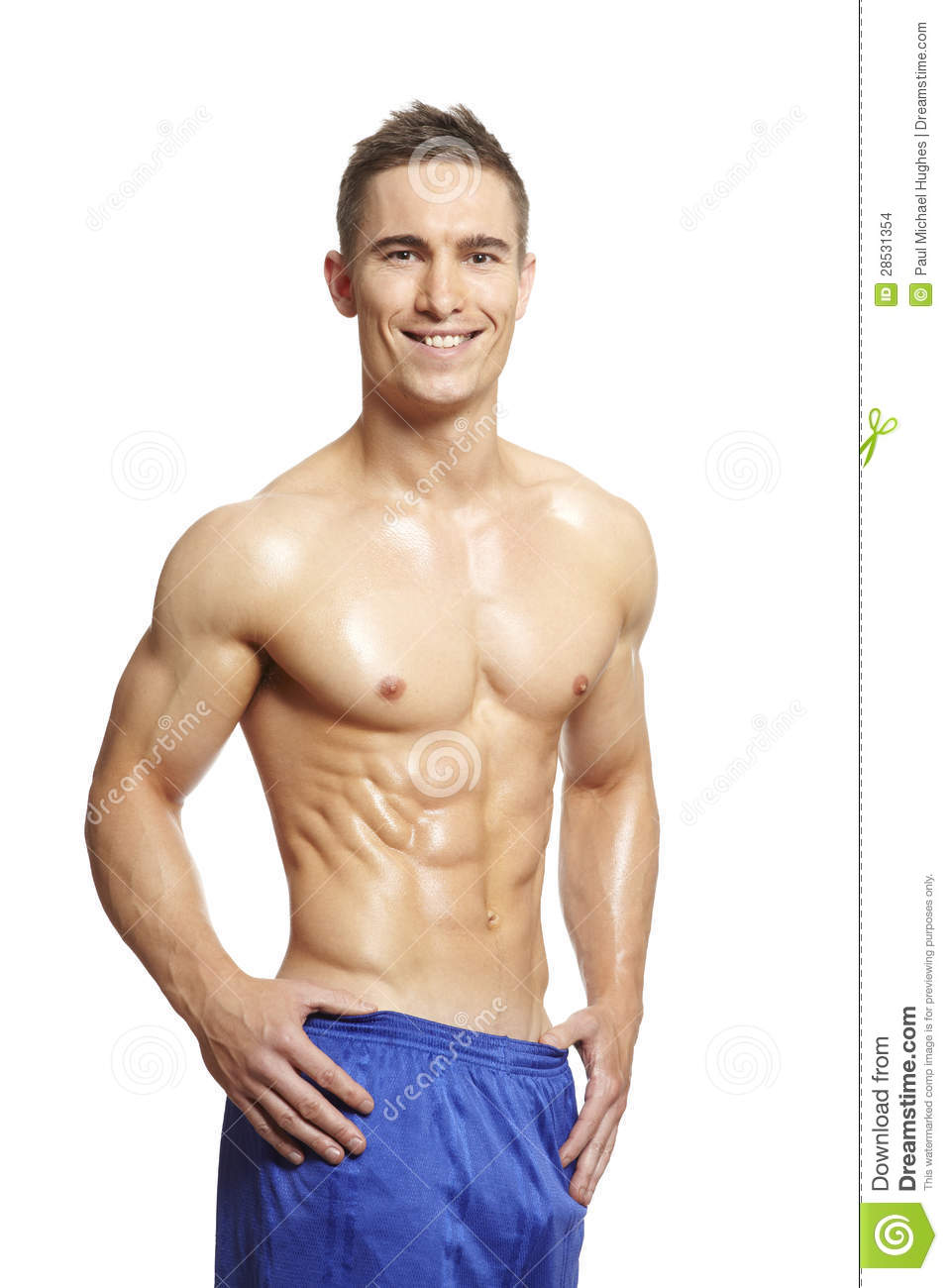 Muscular young man flexing muscles in sports outfit on white ...
