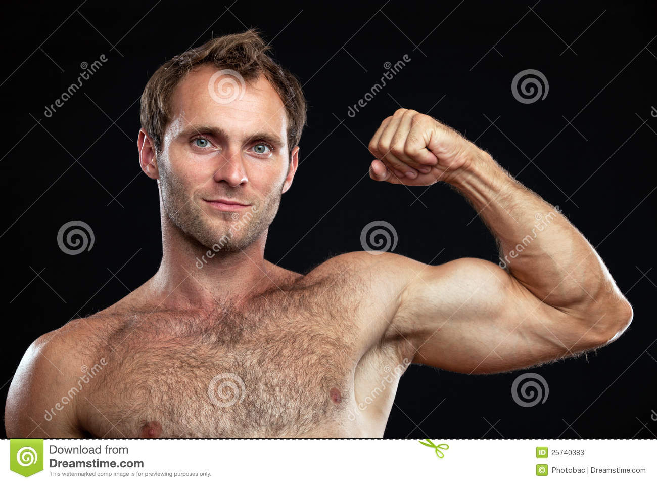 Closeup portrait of muscular young man flexing his bicep against black ...