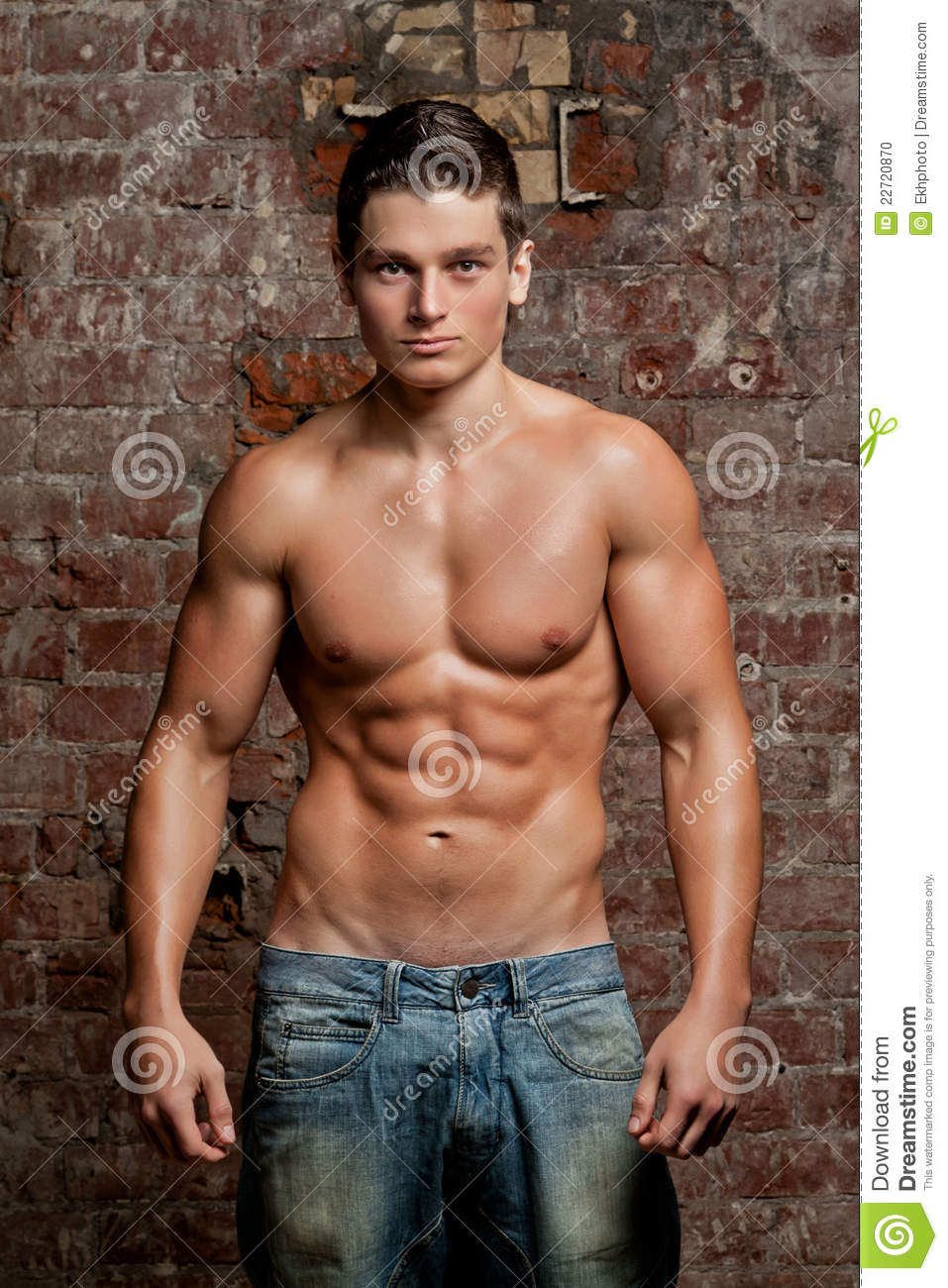 Muscular Young Naked Man Posing In Blue Jeans Stock Photo