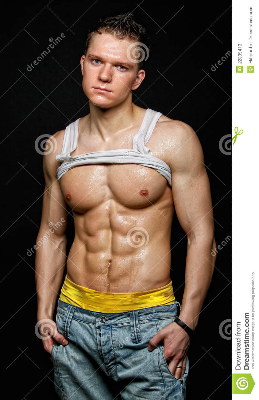 3aae33aff7 Muscular Young Wet Man In The White T-shirt Stock Image - Image of ...